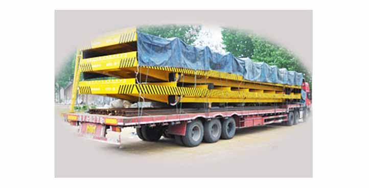 Coils handling rail transfer trailer powered by rails system