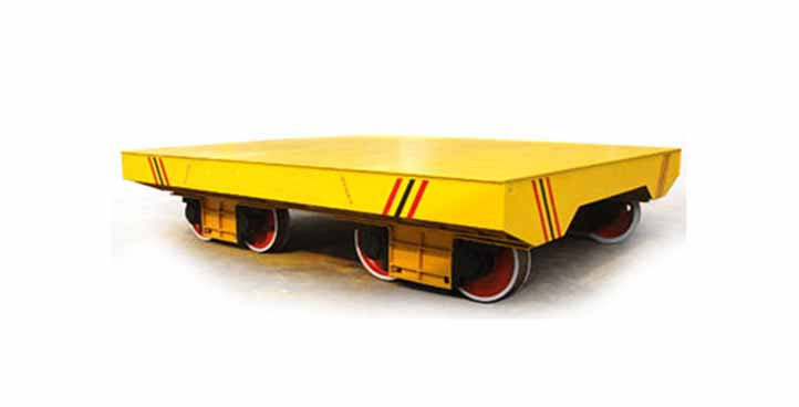 Towed rail trailer for steel mill industry